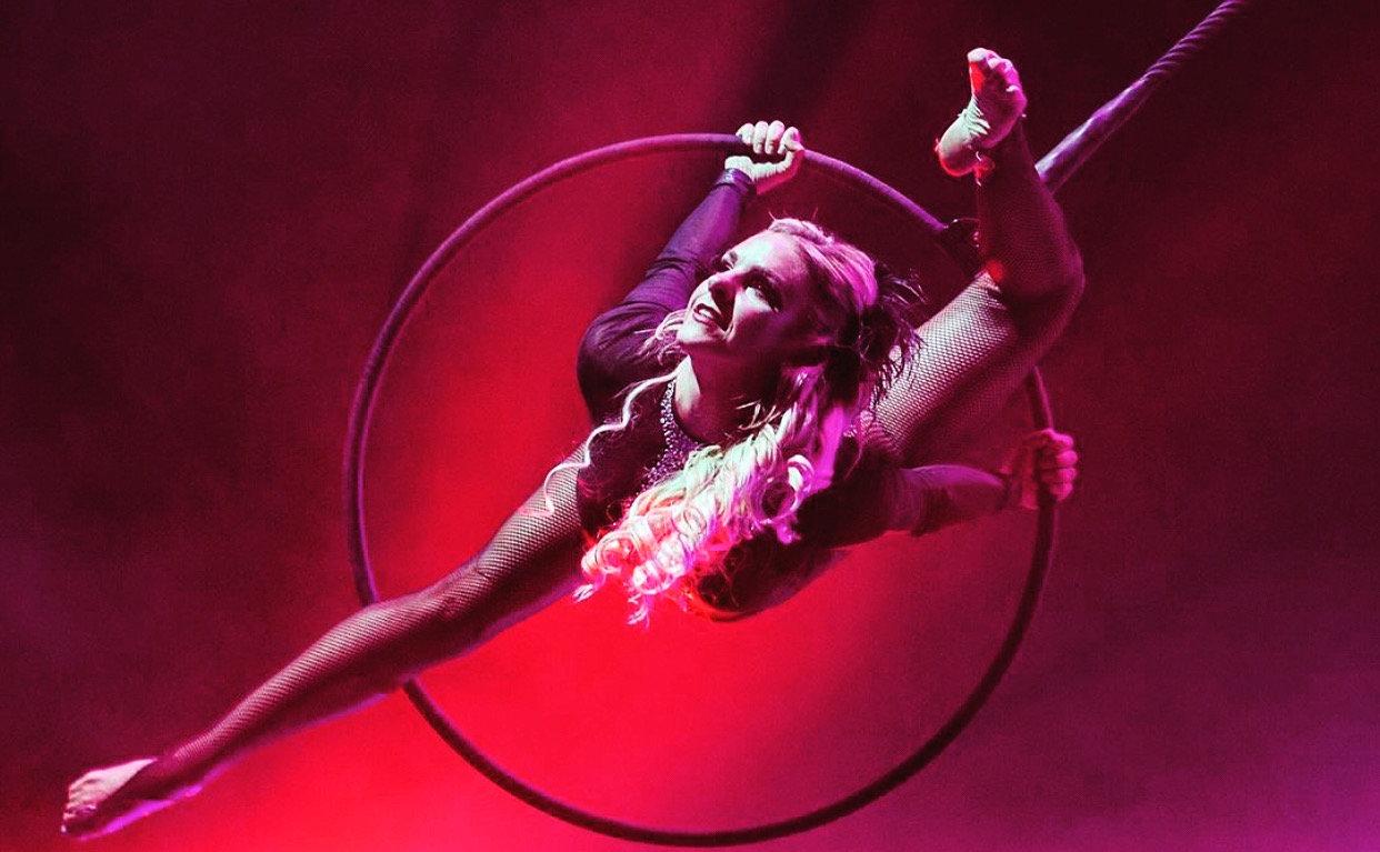 Aerial hoop rolls and drops