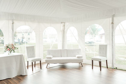 White sofa and tufted chairs