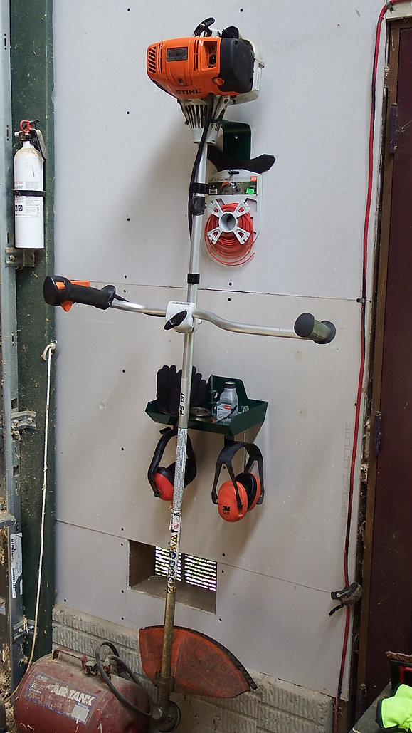 UpHold string trimmer hanger and caddy in action