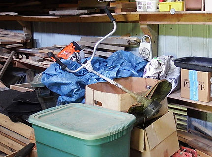 string trimmer thrown on top of stuff in garage