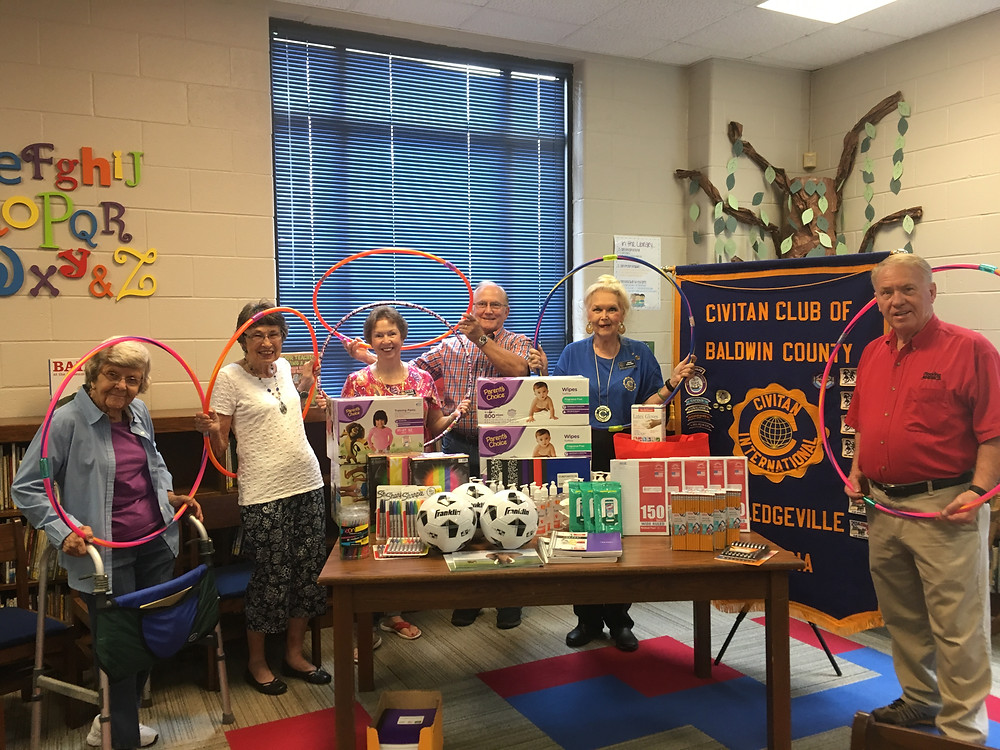 Civitan Club President Darryl Black and other club members making their donation of school supplies.