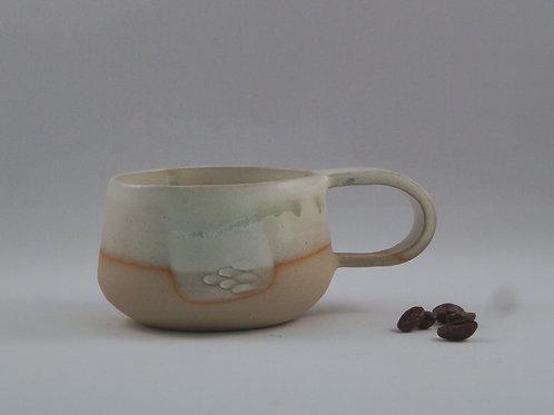 Tasse à café blanc et vert