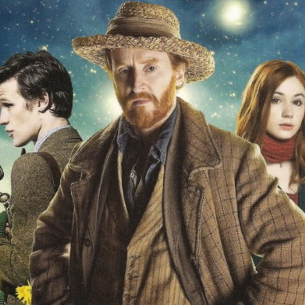 Vincent Van Gogh looks onward as Doctor Who and his companion Amy stand behind him in a painting