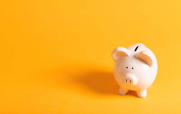 White piggy bank on yellow.jpg