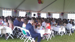 Guests dining in tent