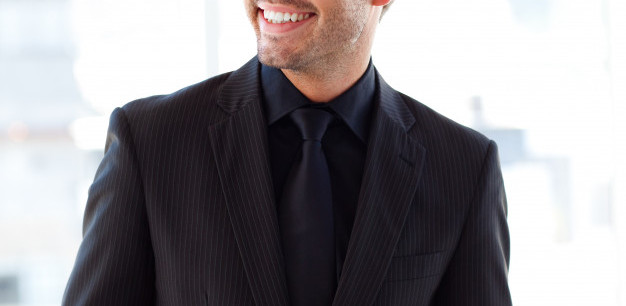 smiling-handsome-businessman-in-office_1