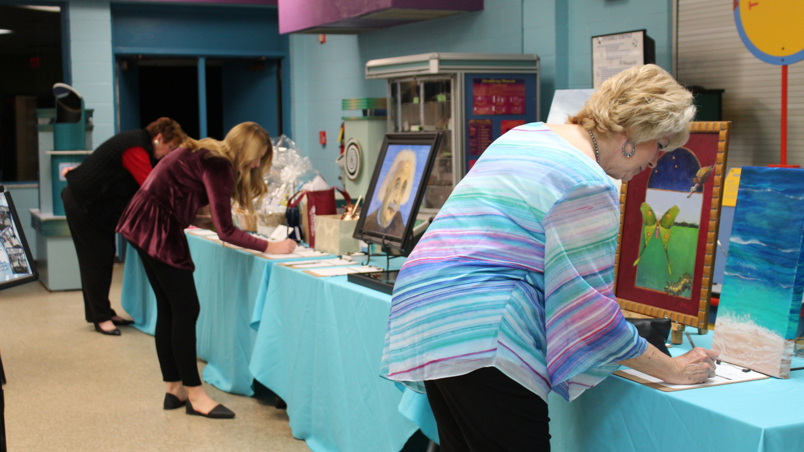 Guests bid on silent auction items