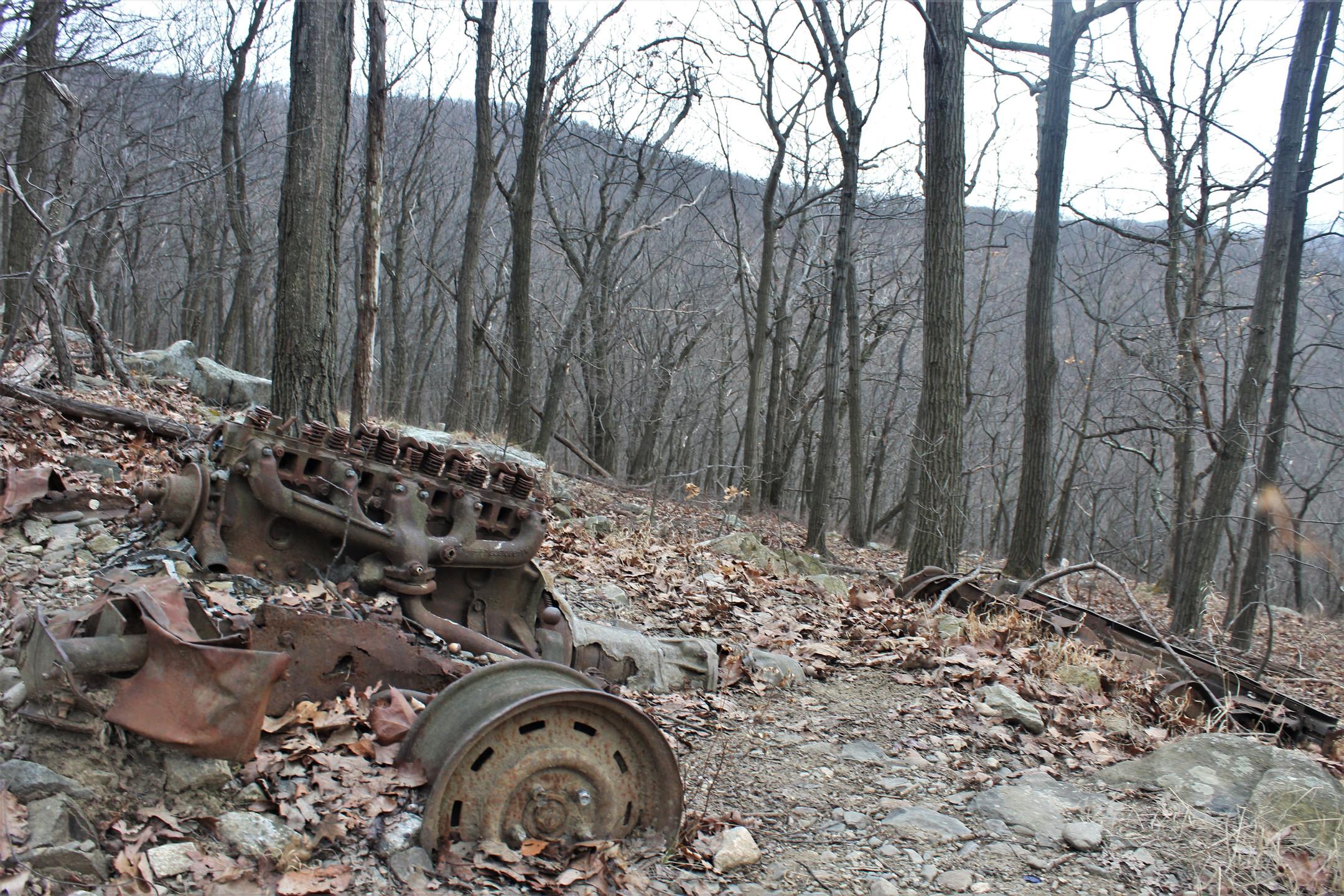 Rusting Car Parts Along Trail