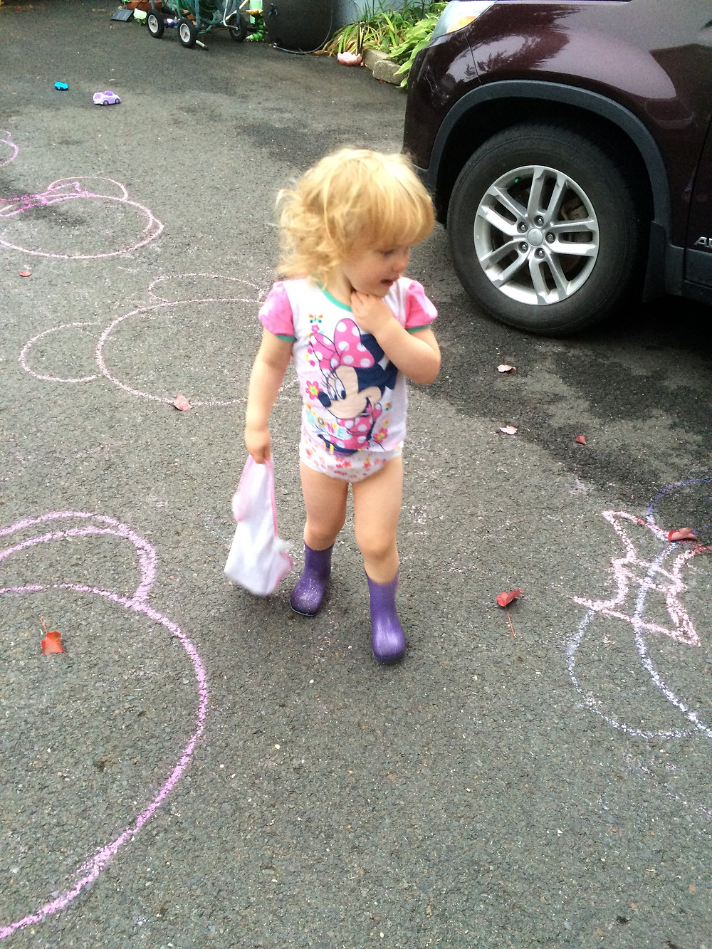 Admiring the Minnie mouse chalk in the driveway