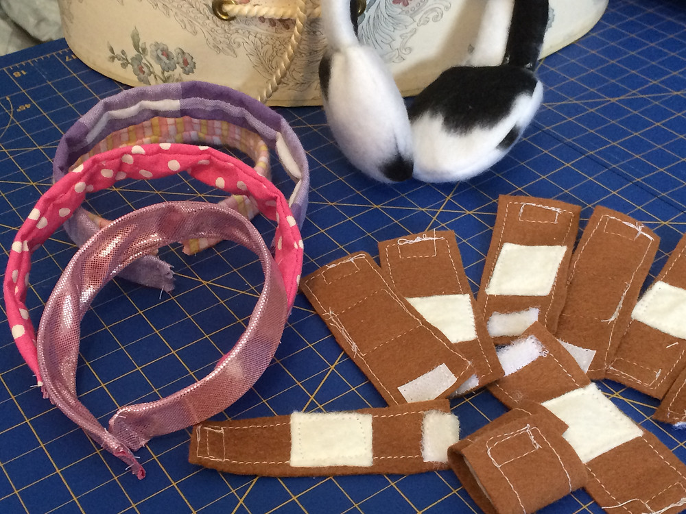 Doll headbands and play bandaids