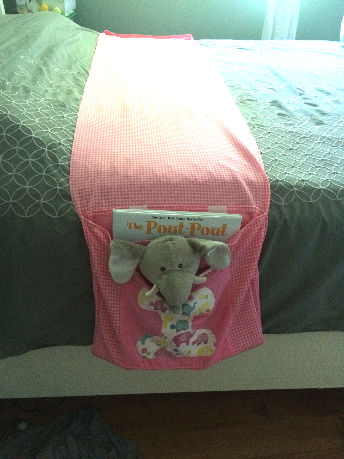 Child's bed book holder