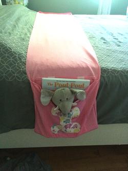 Child's bed book holder