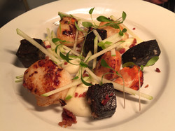 Scallops with black puddng