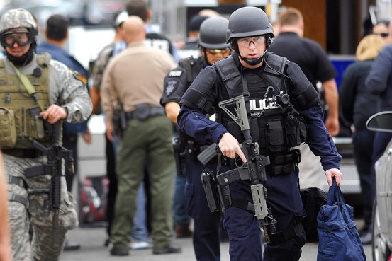 SWAT prepares to make entry into residence