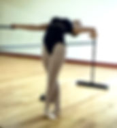 Picture of a ballet dancer practicing at the barre as a fine art print for the wall of your home or office.