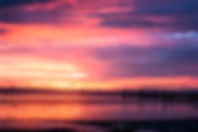 Picture of a sunset over Tampa Bay looking from Bahia Beach in Ruskin to St. Petersburg, FL as a fine art nature print for the wall of your home or office.