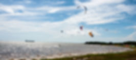 Picture of kite surfers enjoying a day on Tampa Bay at Ft. DeSoto Park near the Sunshine Skyway Bridge as a fine art print for the walls of your home or office.
