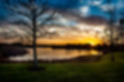 Picture of a a beautiful sunrise over a lake in the Valhalla subdivision of Riverview, FL as a fine art nature print for the wall of your home or office.