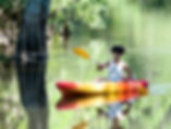 A person kayaking as a fine art print for the walls of your home or office.