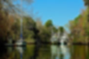 Picture of shrimp boats anchored in the Wirhlacoochee River near Inglis, Florida as a fine art print for the wall of your home or office.