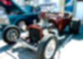 Picture of a skull like breather on a carburator of a hot rod at a Old Town Florida car show as a fine art print for the wall of your home or office.