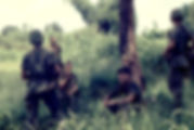 Picture of a US Army patrol taking a smoke break in Vietnam in 1967 as a fine art print for the wall of your home or office.