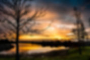 Picture of a sunrise over a lake in Riverview, Florida as a fine art nature print for the wall of your home or office.