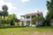 Picture of a two story columned house in Homeland, Florida as a fine art print for the wall of your home or office.