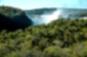 Picture of Iguazu Falls from a distance on the Argentine side of the river as a fine art print for the wall of your home or office.