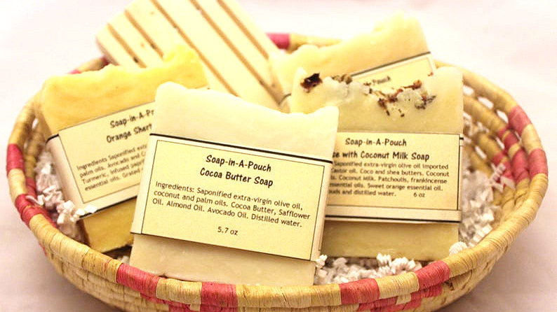 Handmade Soaps in a Basket and Wooden Soap Dish