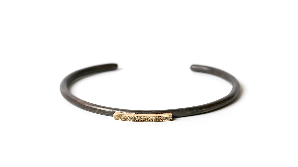 BLACKENED STERLING CUFF BRACELET WITH A 14K GOLD BAR