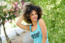 tank-top-mockup-of-a-woman-with-natural-curly-hair-posing-by-a-street-34223-r-el2.png