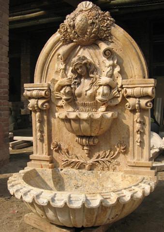 Wandbrunnen mit Frauenkopf