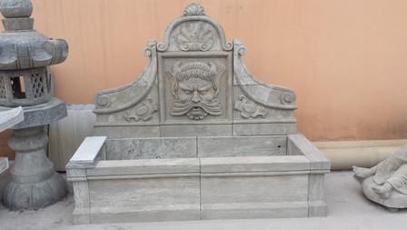 Wandbrunnen mit Männergesicht