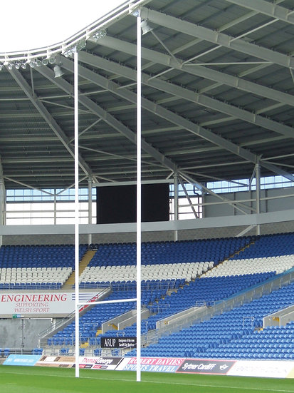Set of lightweight socketed aluminium rugby posts from Harrod Sport in a stadium.