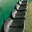 Black seats in the Fibretech team shelter from Harrod Sport for hockey or football.