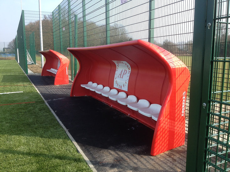 Red 10-seater fibreglass and polyester resin Fibretech team shelter from Harrod Sport for hockey or football.