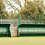 Dark green 5 and 10-seater fibreglass and polyester resin Fibretech team shelters from Harrod Sport for hockey or football.