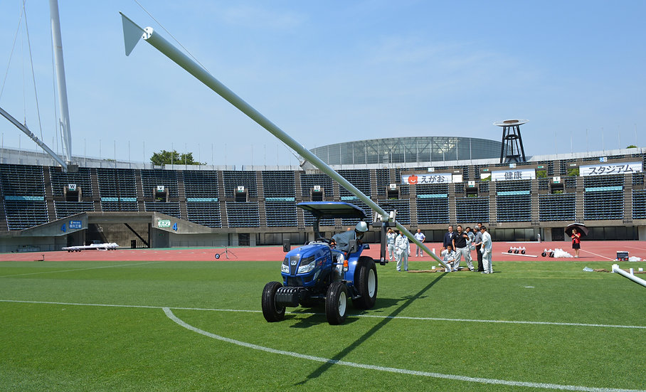 Tractor-mounted hinged rugby post lifter from Harrod Sport.