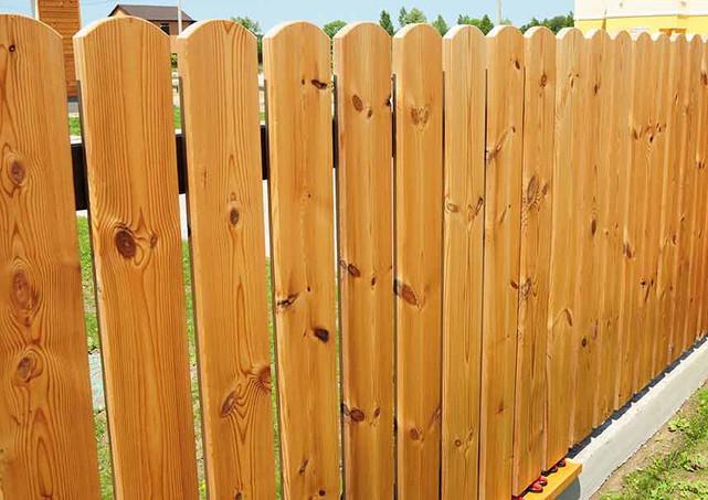 Classic dog-ear cedar fence