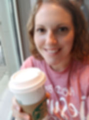 Young woman holding coffee cup.