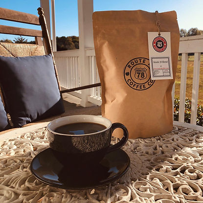 A warm cup of coffee and a bag of Route 78 Coffee on a table