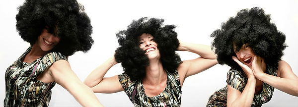 happy woman wearing an afro wig