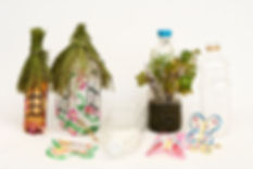 Planters and bird feeders from recycled bottles