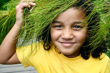 """Book Cover photograph of a young girl """"In the gardens"""" an ELRU Publication"""