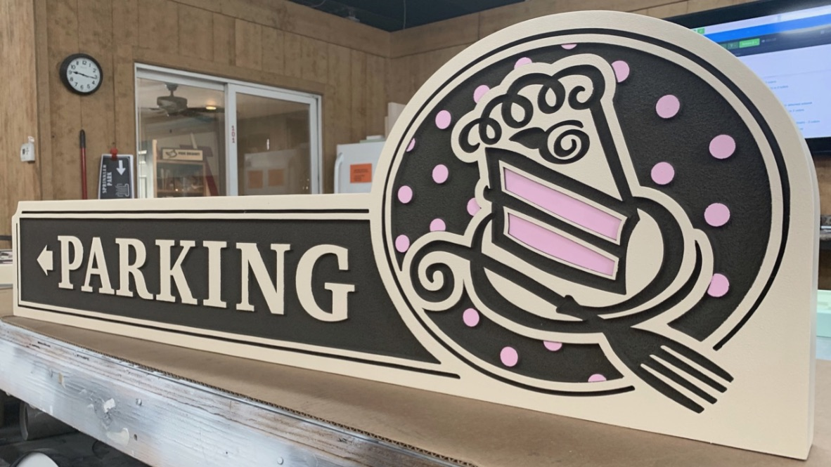 Piece a'Cake parking sign