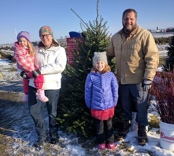 Family photo with Christmas tree