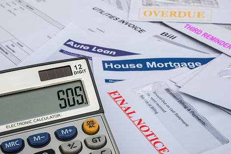 different invoices and bills and a calcu