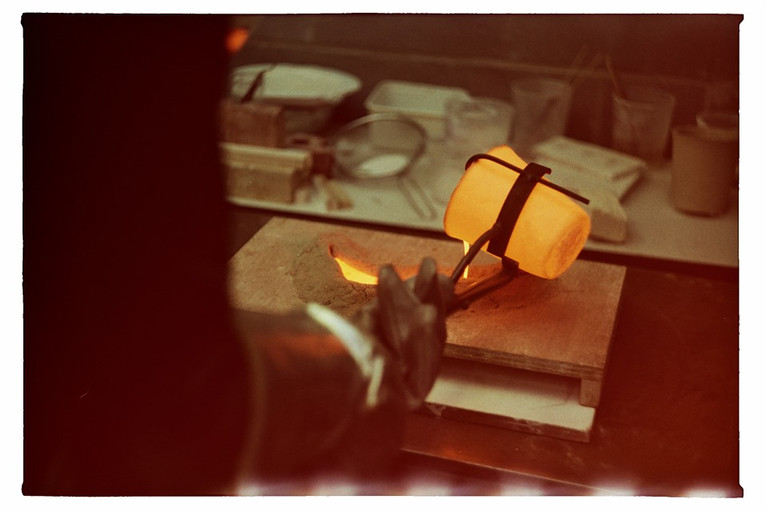 sand mold and the hot glass