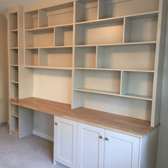 Oak desk with shelving above and cupboards below